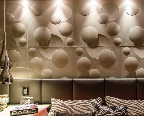 3D cement panel behind a bed